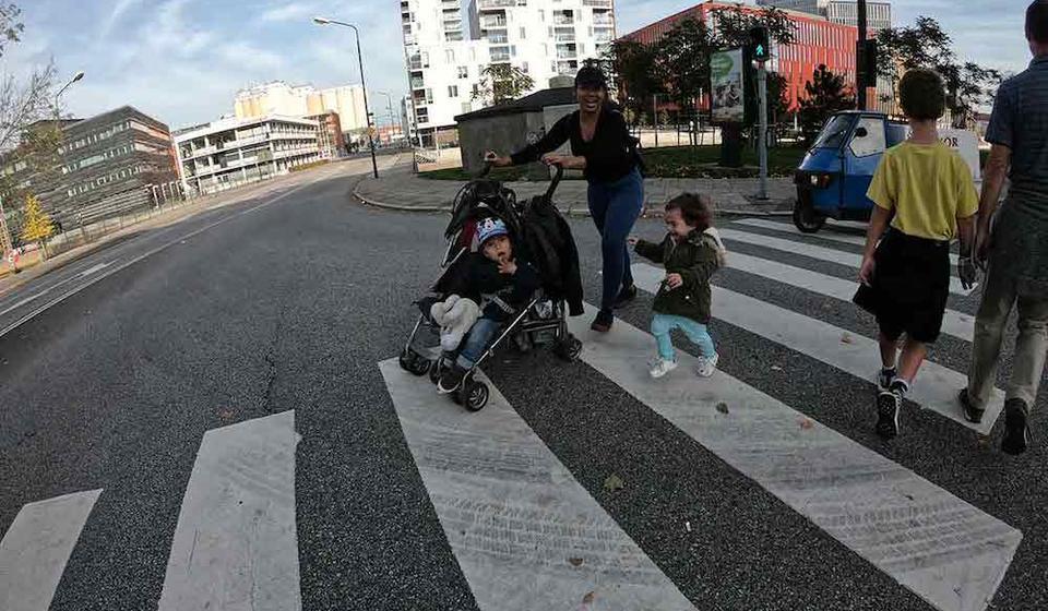 Family with stroller in crosswalk
