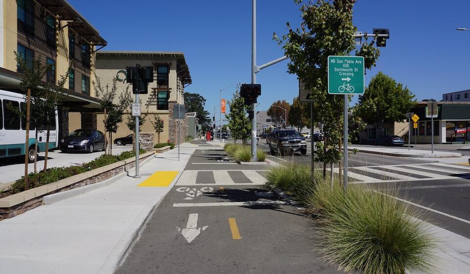 Pedestrian in crosswalk near BART station in Berkeley, CA