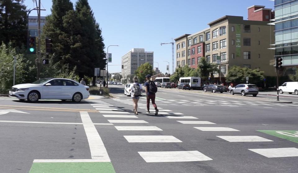 Pedestrians in crosswalk on Hearst Avenue, Berkeley, CA